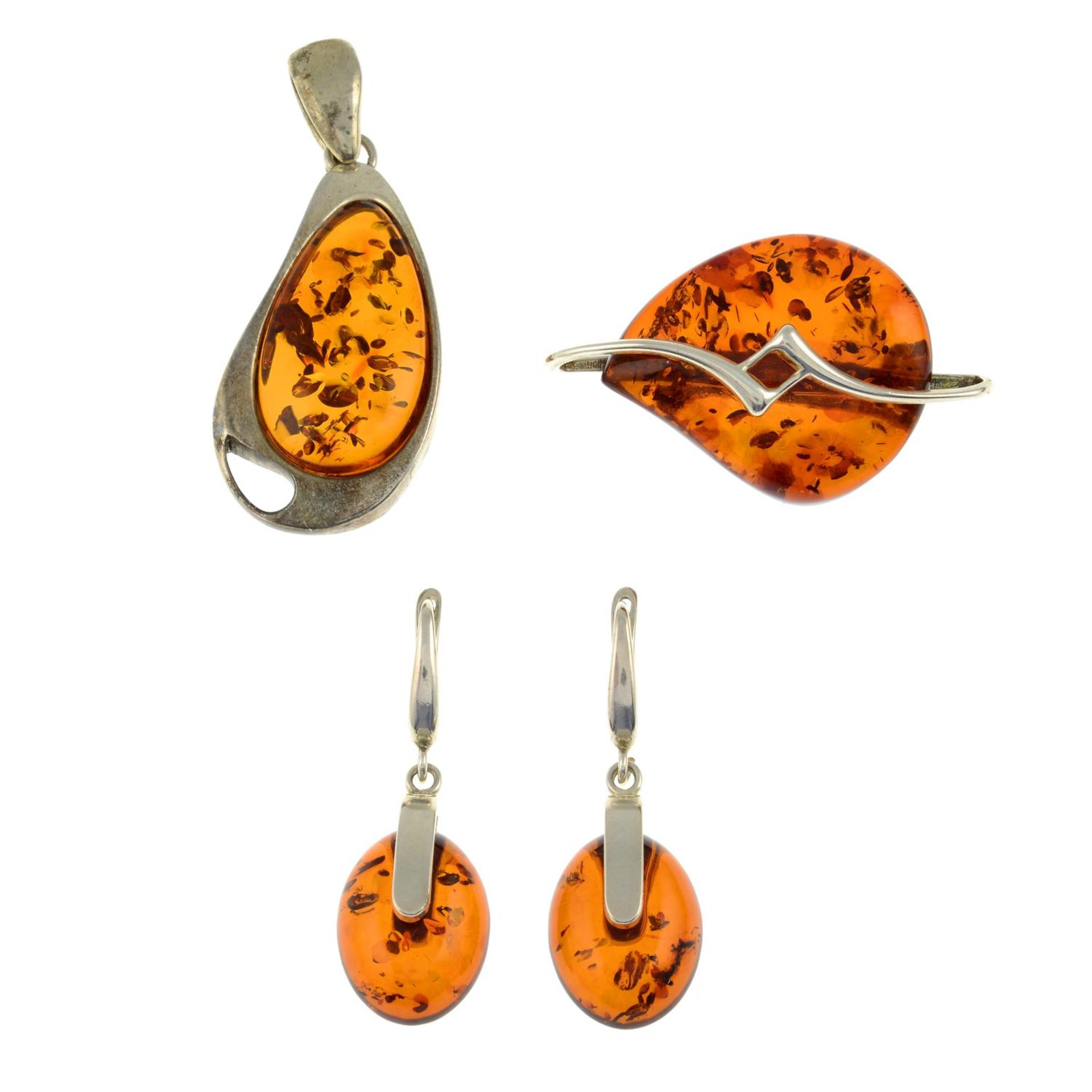 A selection of amber jewellery and a pair of tigers eye cufflinks.Many with marks to indicate