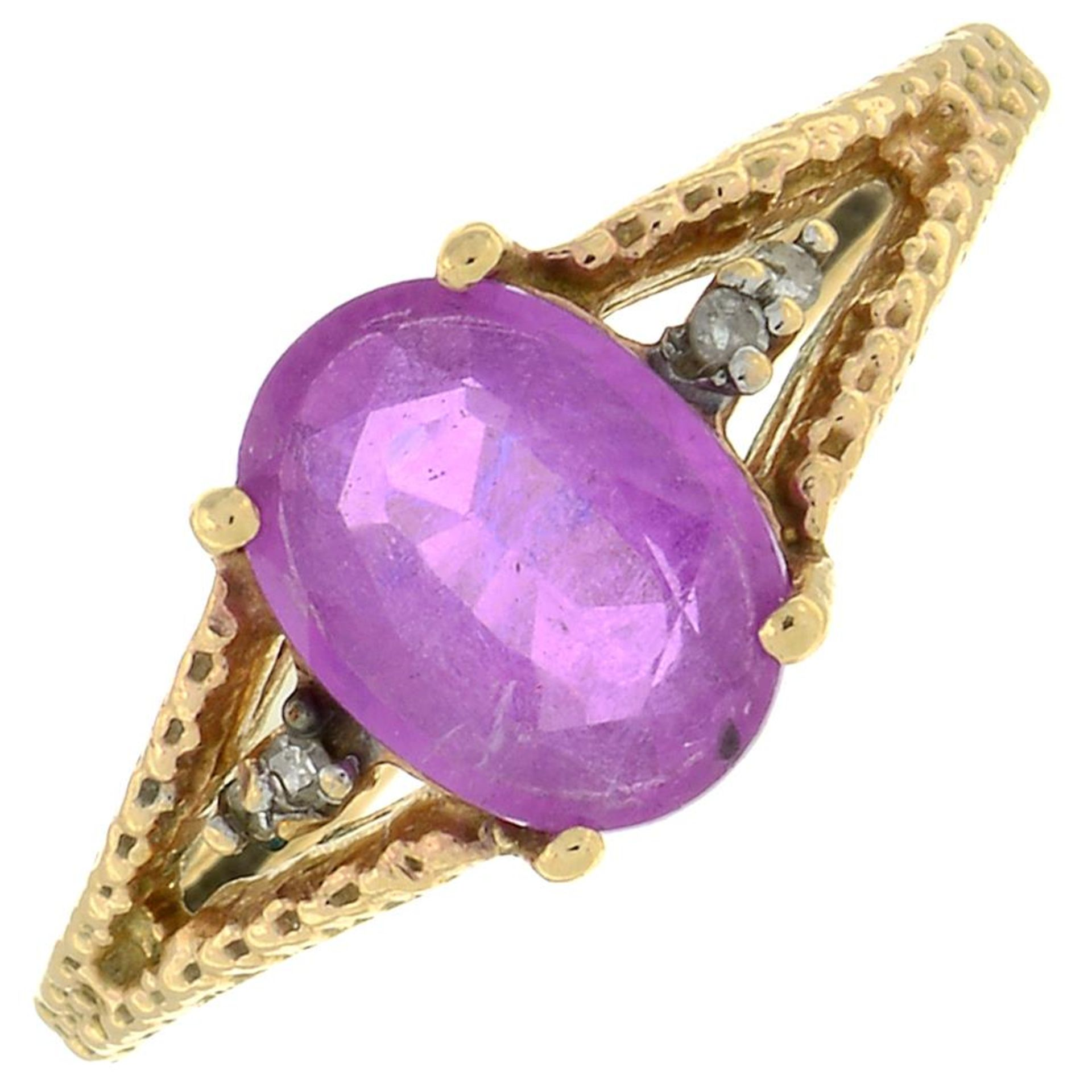 A 9ct gold pink sapphire and diamond ring.Hallmarks for Birmingham.Ring size I.