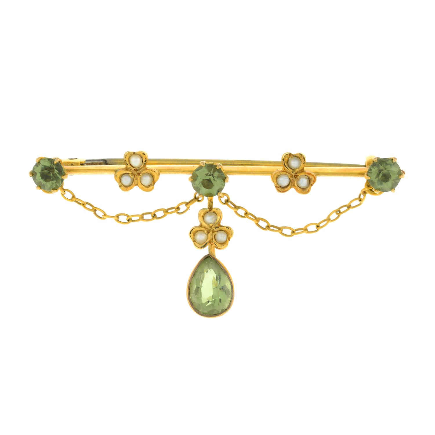 An Edwardian peridot and split pearl brooch.