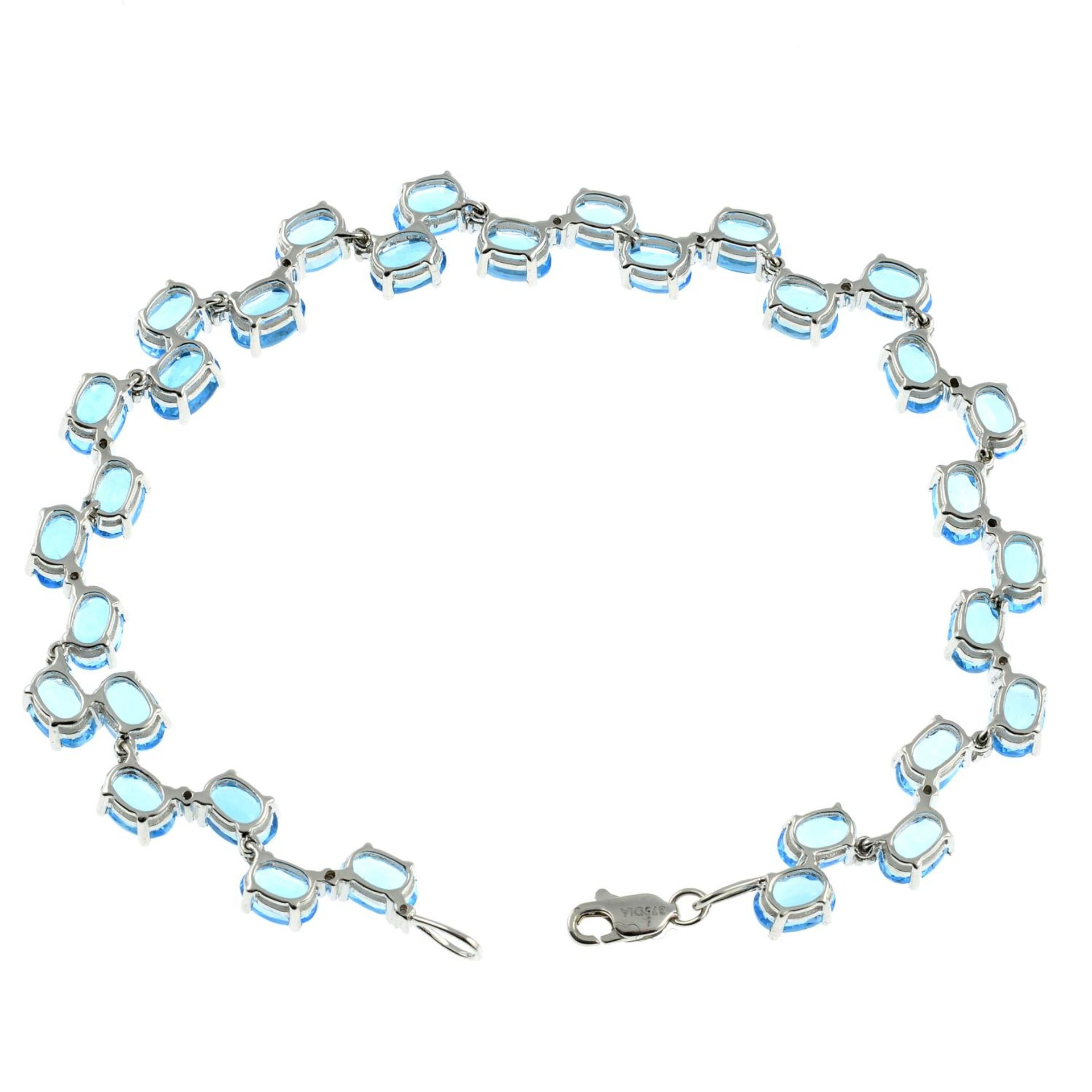 A 9ct gold topaz and diamond bracelet.Stamped 375.Length 17.5cms. - Image 2 of 2