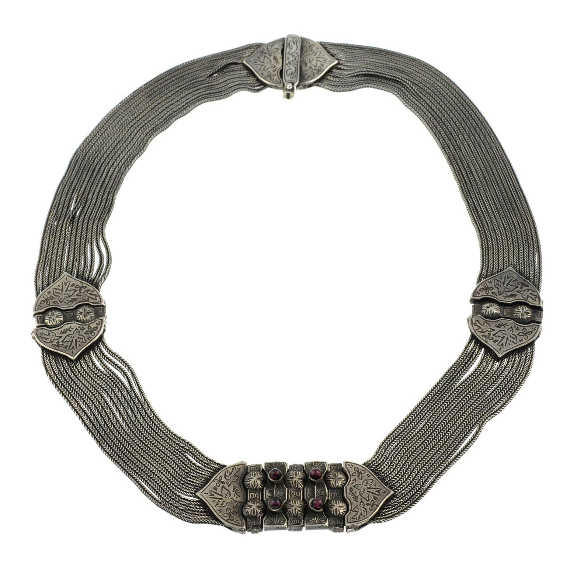 A garnet multi-strand chain necklace.