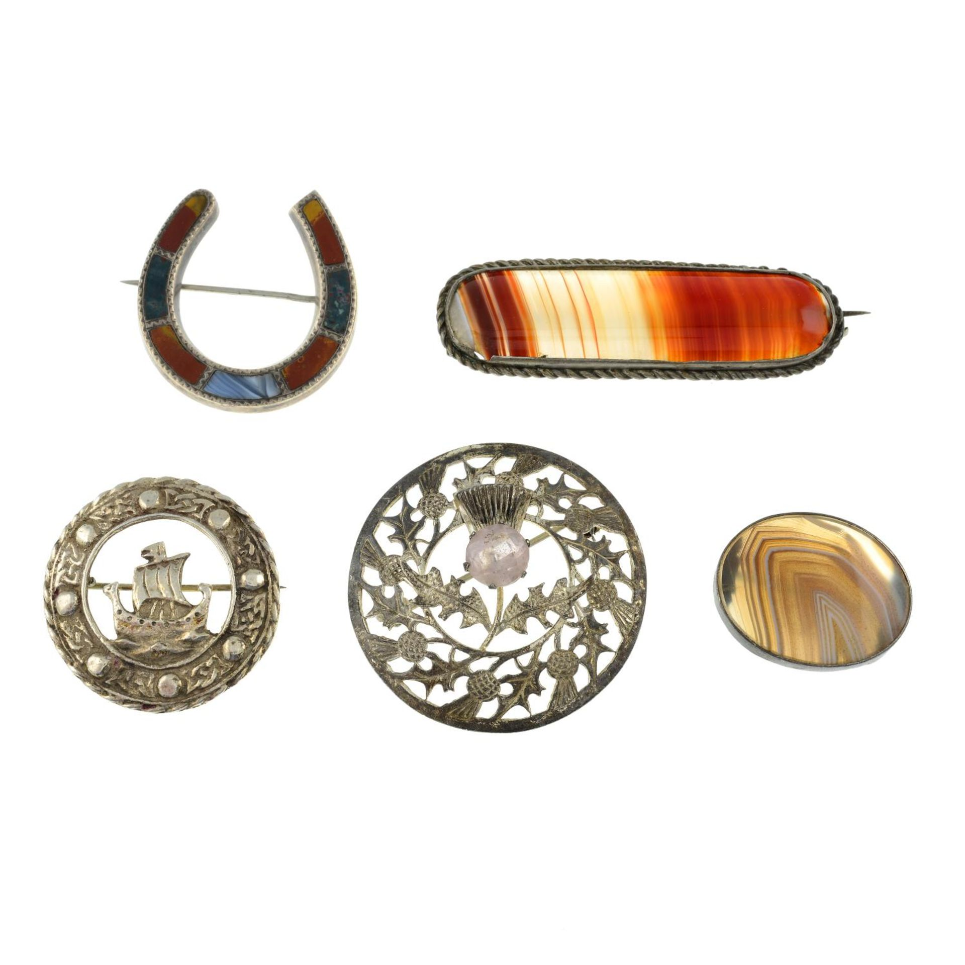 A selection of mainly Scottish agate brooches, to include an agate panel horseshoe brooch.