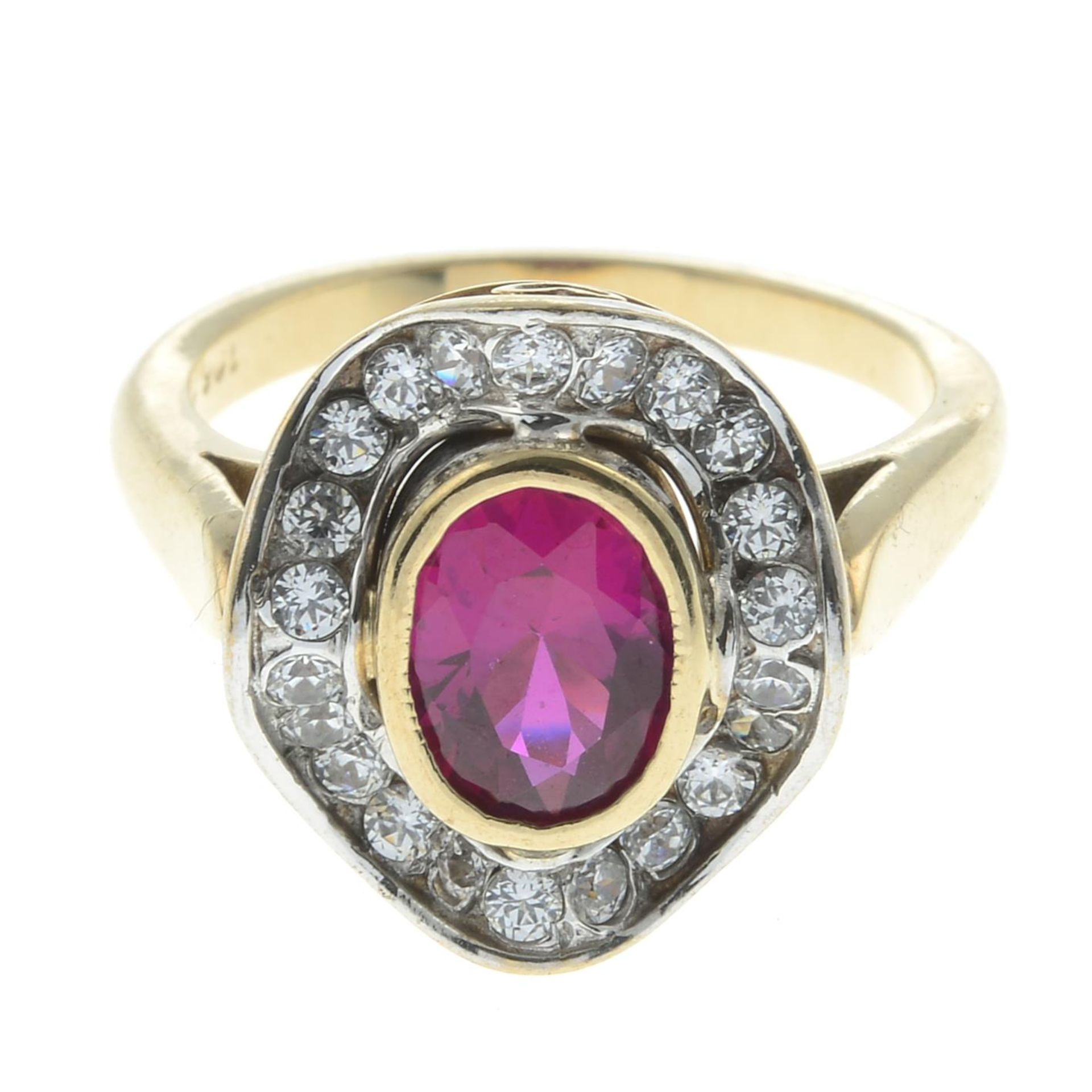 A synthetic ruby and cubic zirconia cluster ring.Stamped 9ct.Ring size N1/2.