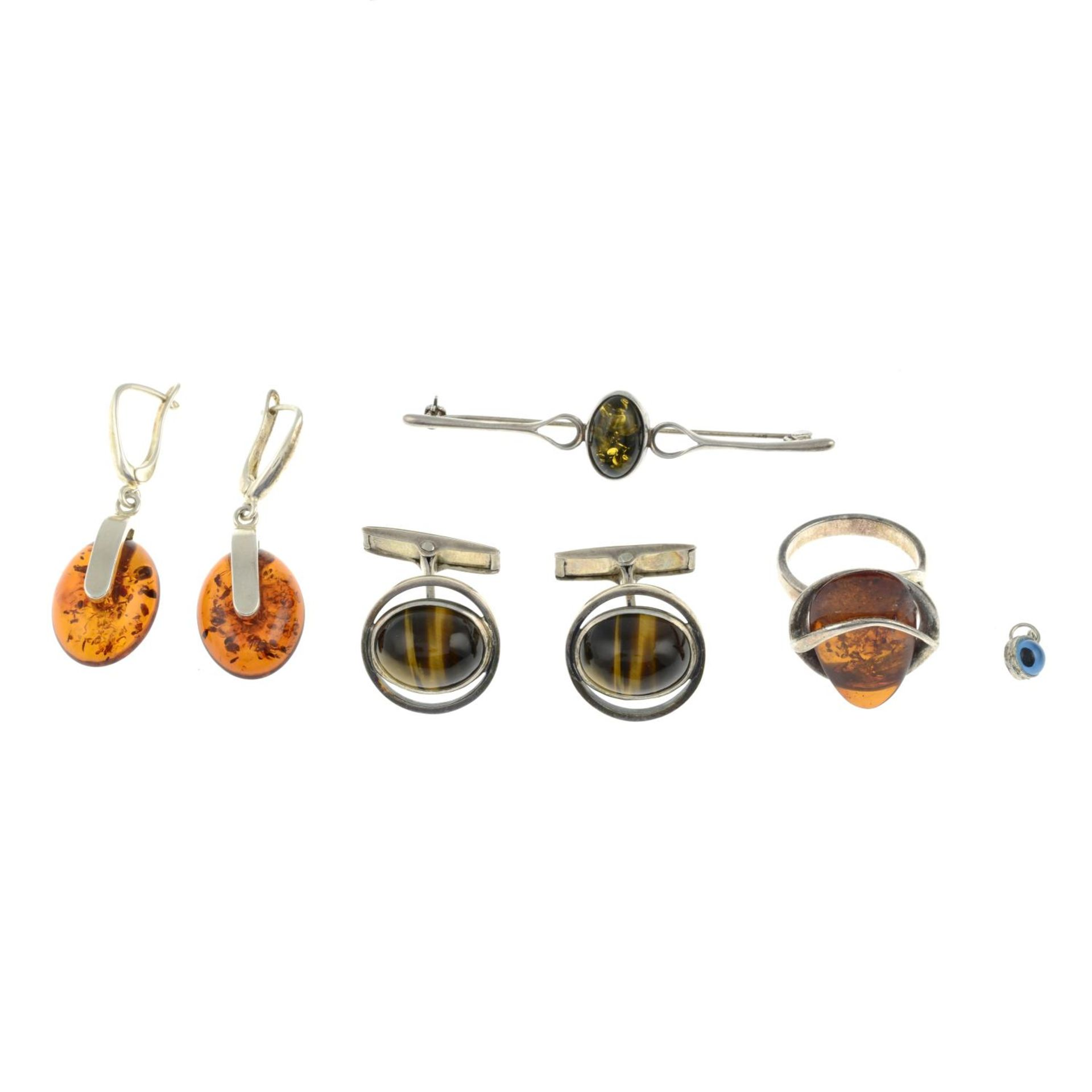 A selection of amber jewellery and a pair of tigers eye cufflinks.Many with marks to indicate - Image 3 of 3