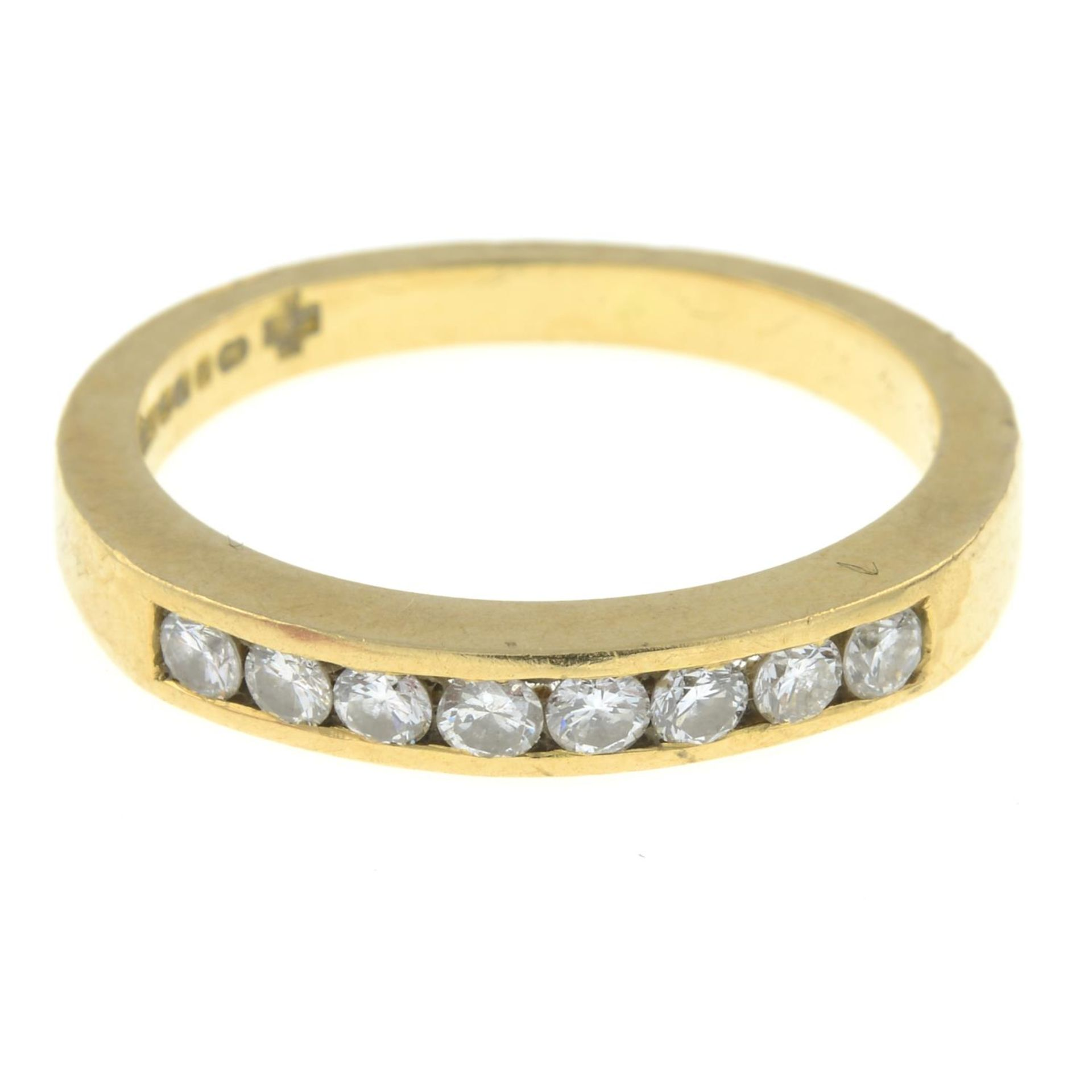 An 18ct gold brilliant-cut diamond half eternity ring.Estimated total diamond weight