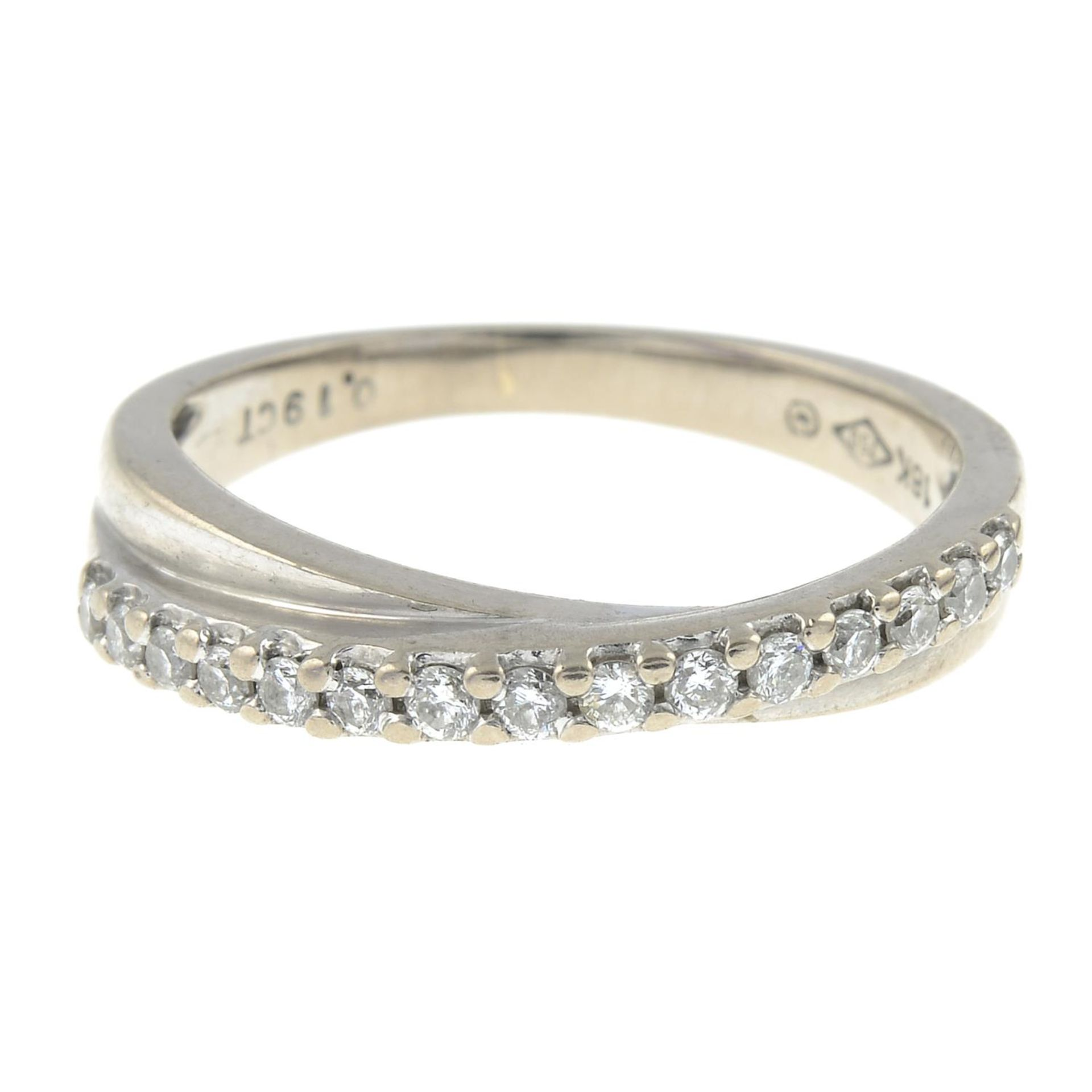 A brilliant-cut diamond line crossover ring.Total diamond weight 0.19ct,