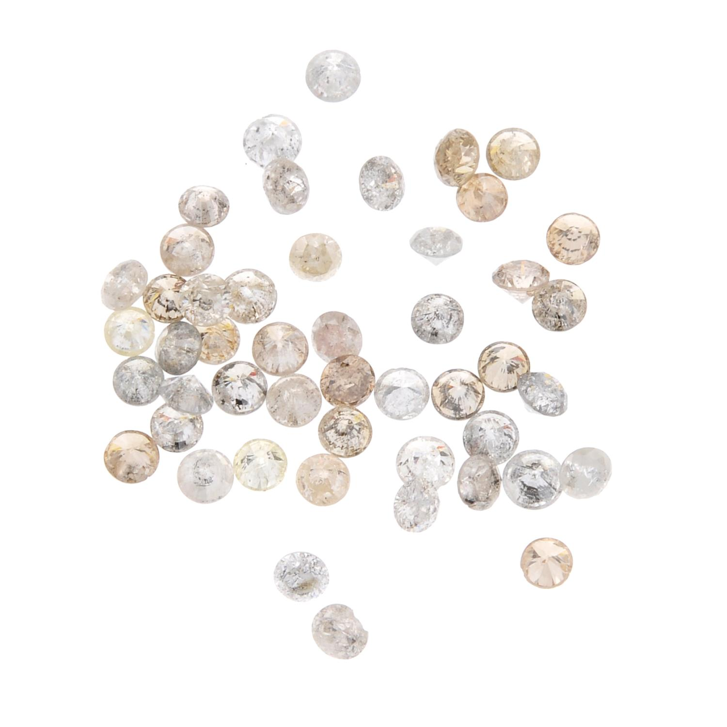A small selection of round brilliant-cut melee and 'brown' melee diamonds.