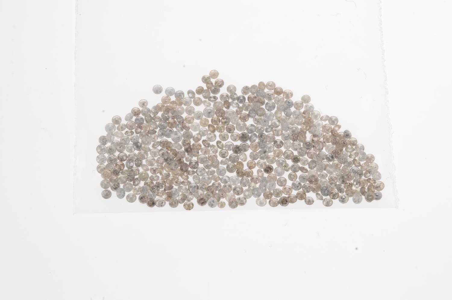 A small selection of round brilliant-cut melee diamonds and 'brown' melee diamonds. - Image 2 of 2
