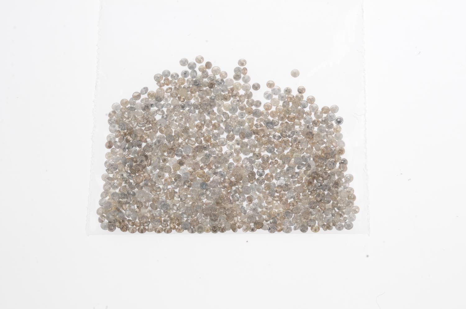 A small selection of round brilliant-cut melee diamonds and 'brown' and 'yellow' melee diamonds. - Image 2 of 2