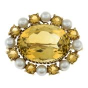 A 9ct gold citrine and cultured pearl brooch.Hallmarks for Birmingham, 1966.Length 3cms.