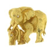 An elephant and calf brooch, each with diamond accent eye.Length 3.7cms.