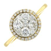 An 18ct gold brilliant-cut diamond cluster ring.Total diamond weight 0.72ct.Hallmarks for