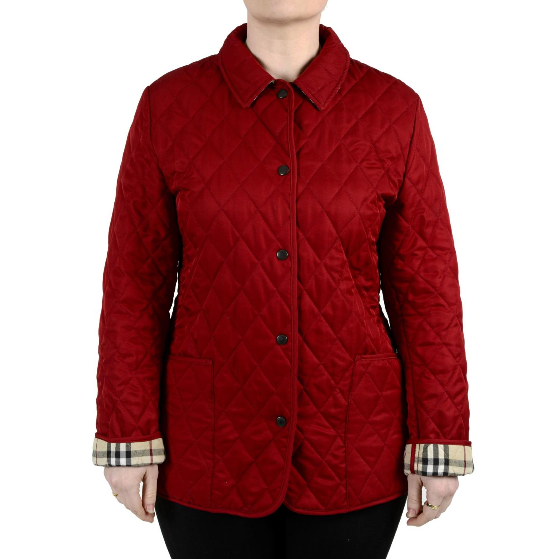BURBERRY - a red quilted jacket.