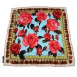 DOLCE & GABBANA - a multicoloured silk scarf.