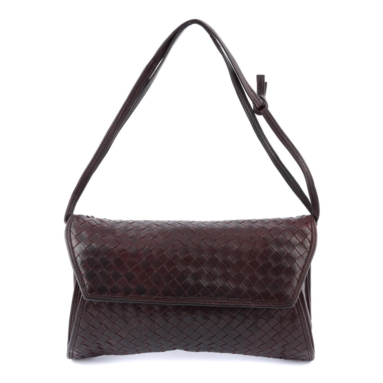 BOTTEGA VENETA - a woven fold-over crossbody handbag.