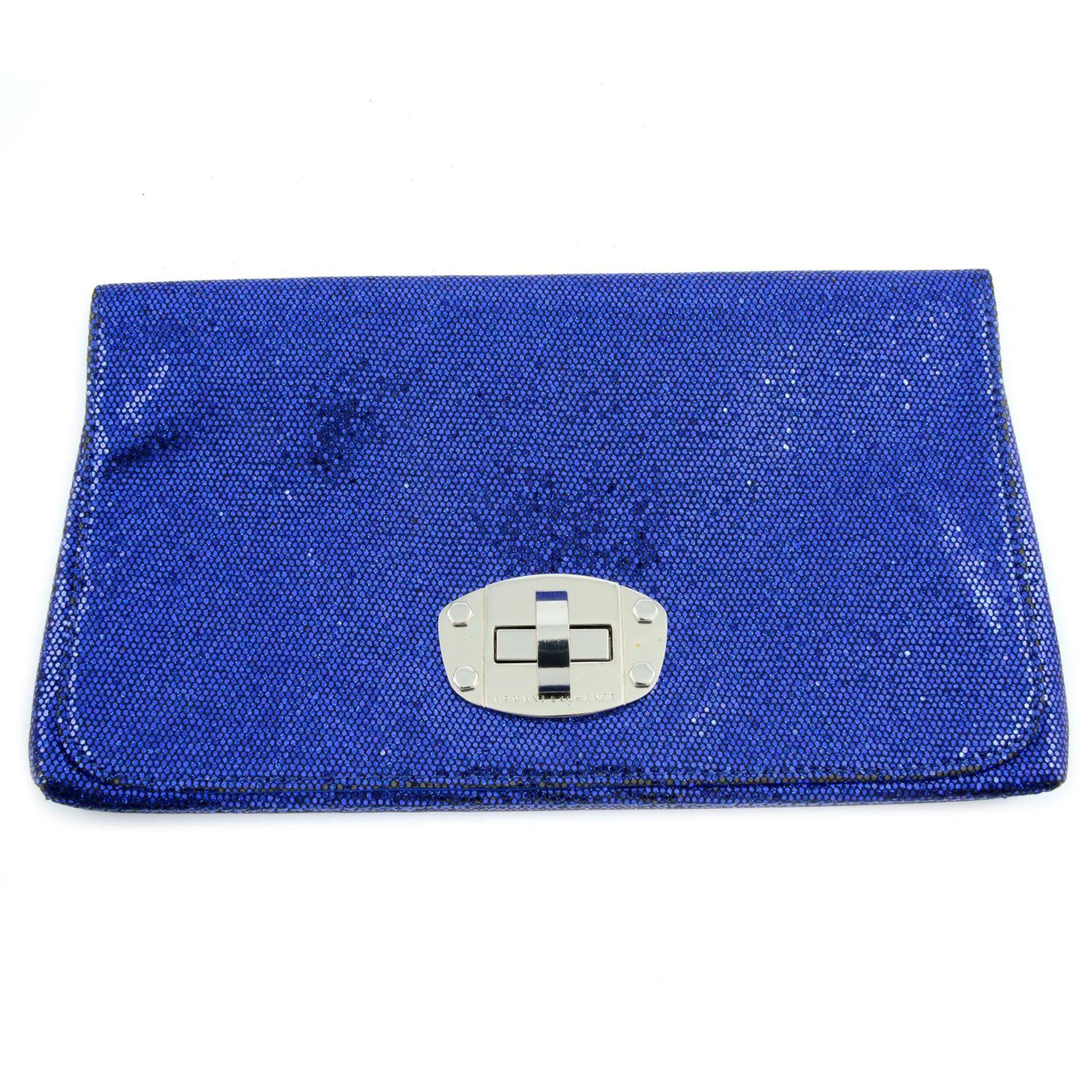 ARMANI EXCHANGE - a blue glitter clutch.