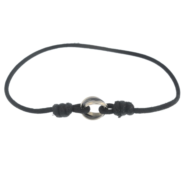 CARTIER - a cord 'Trinity' bracelet.