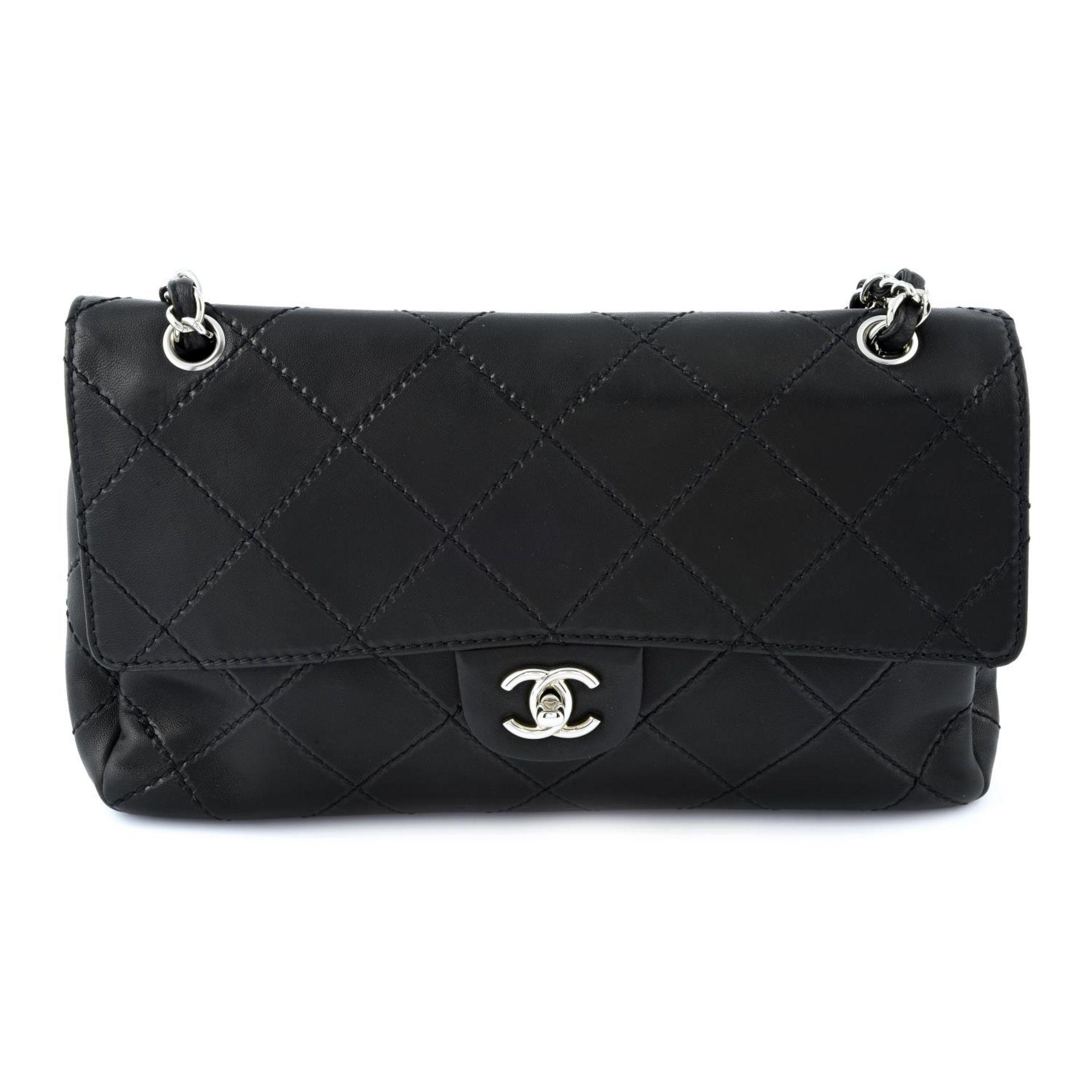 CHANEL - a maxi single flap handbag.