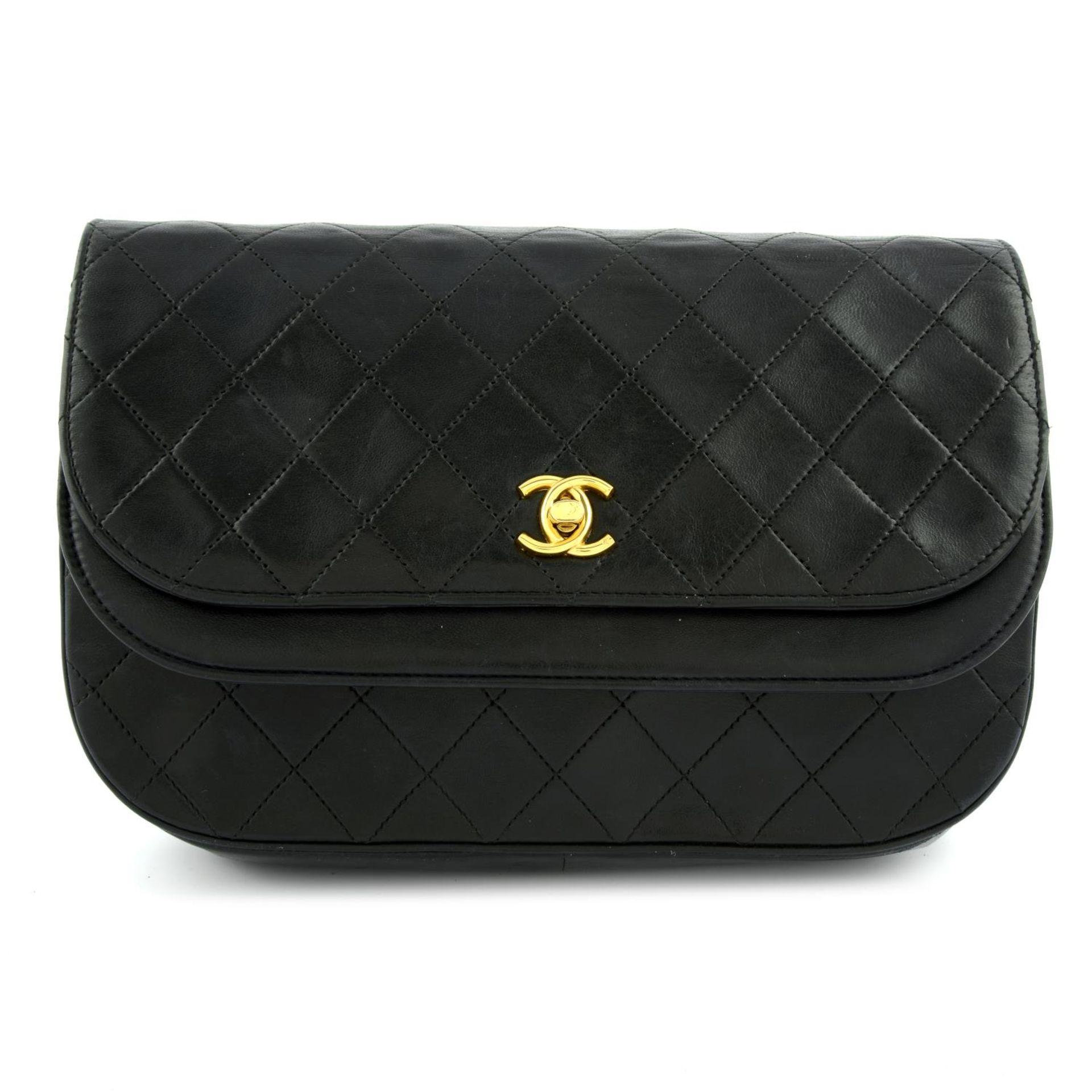 CHANEL - a leather double flap handbag.