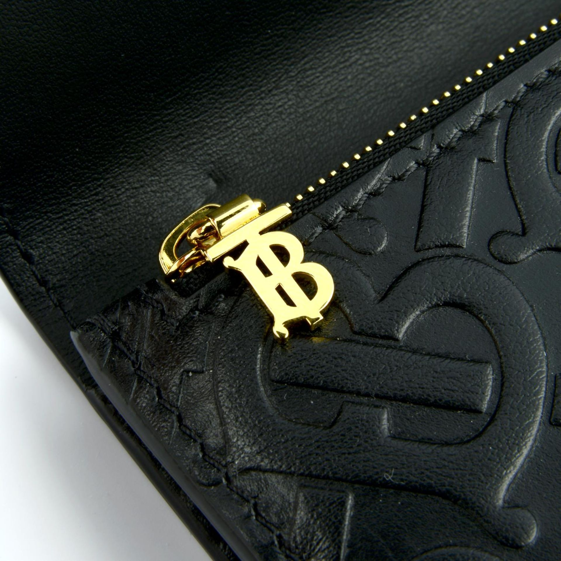 BURBERRY - a black leather monogram continental wallet. - Image 4 of 4