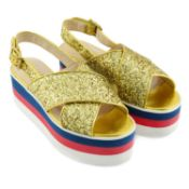 GUCCI - a pair of gold glitter platform sandals.