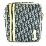 CHRISTIAN DIOR - a blue coated Trotter canvas messenger handbag.