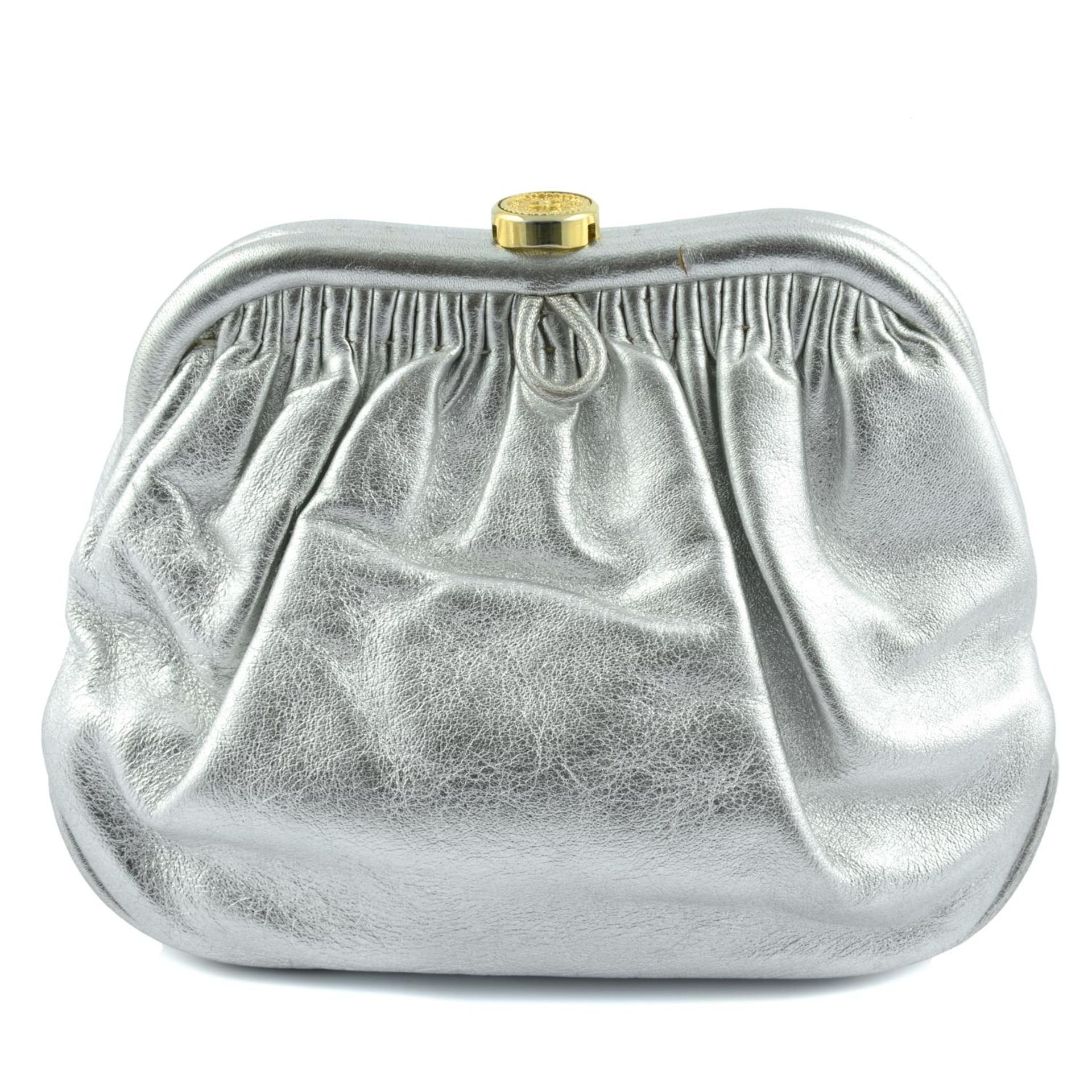 CHANEL - a vintage metallic kiss-lock clutch with chain.