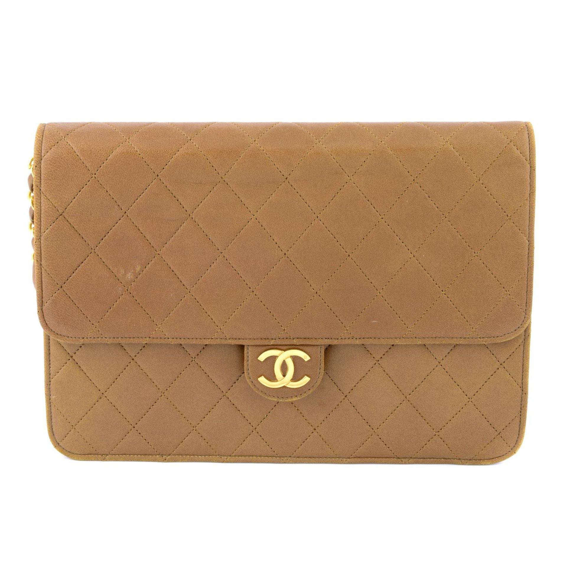 CHANEL - a vintage tan single flap handbag.