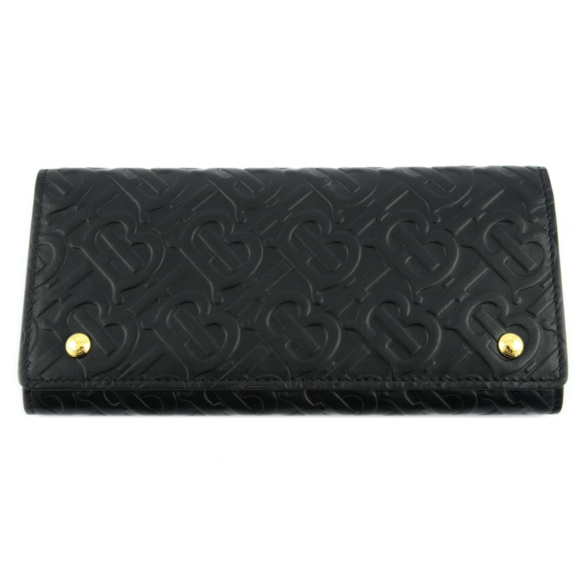 BURBERRY - a black leather monogram continental wallet.