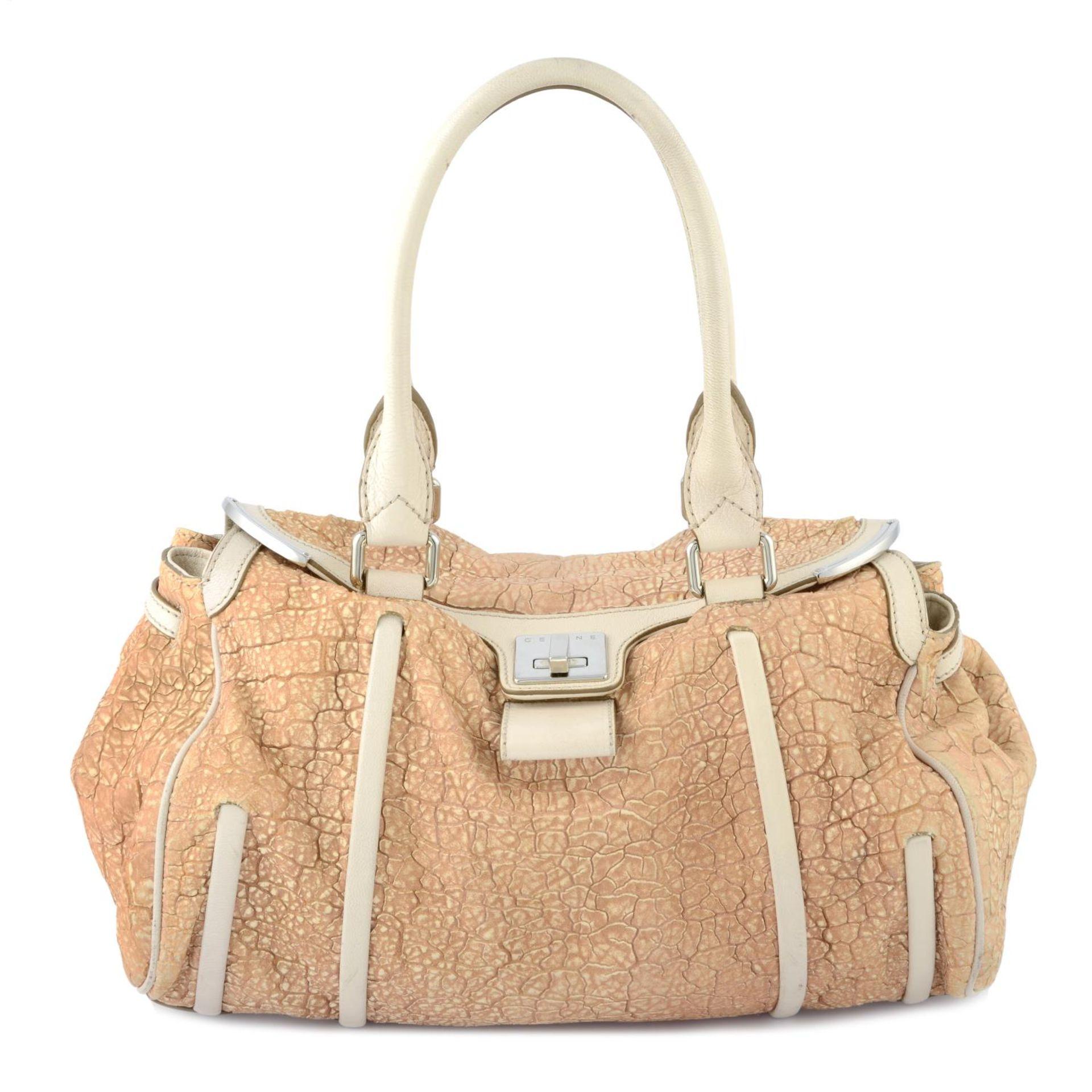 CÉLINE - a nude textured leather handbag.