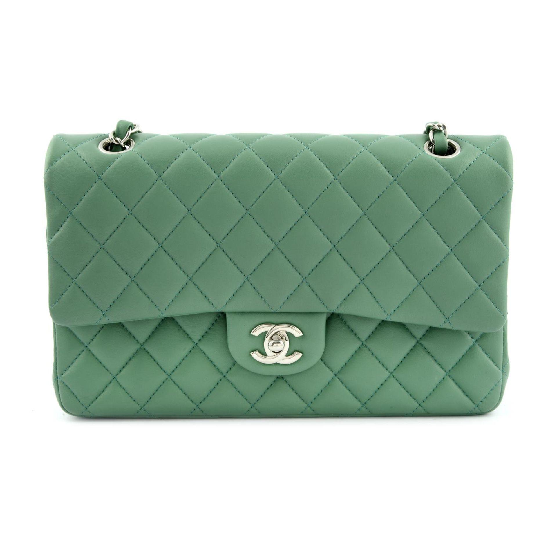 CHANEL - a green medium classic double flap handbag.