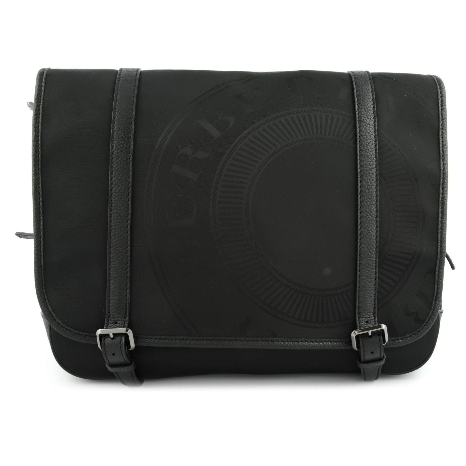 BURBERRY - a nylon messenger satchel.