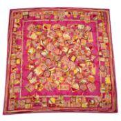 LOUIS VUITTON - a silk scarf.