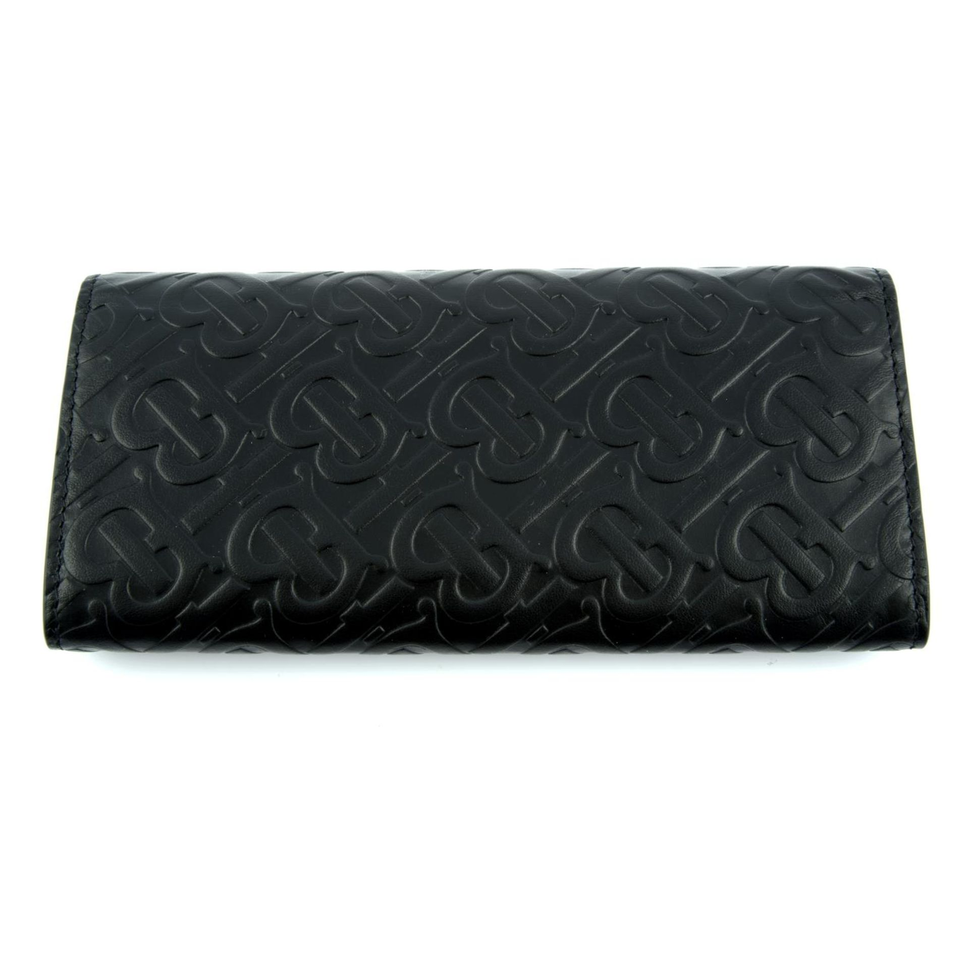 BURBERRY - a black leather monogram continental wallet. - Image 2 of 4