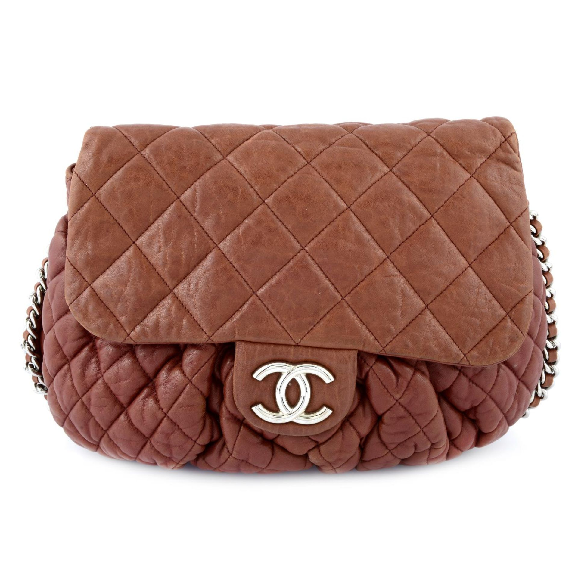 CHANEL - a quilted lambskin leather chain around handbag.