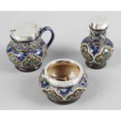 A silver mounted Doulton Lambeth stoneware condiment set,