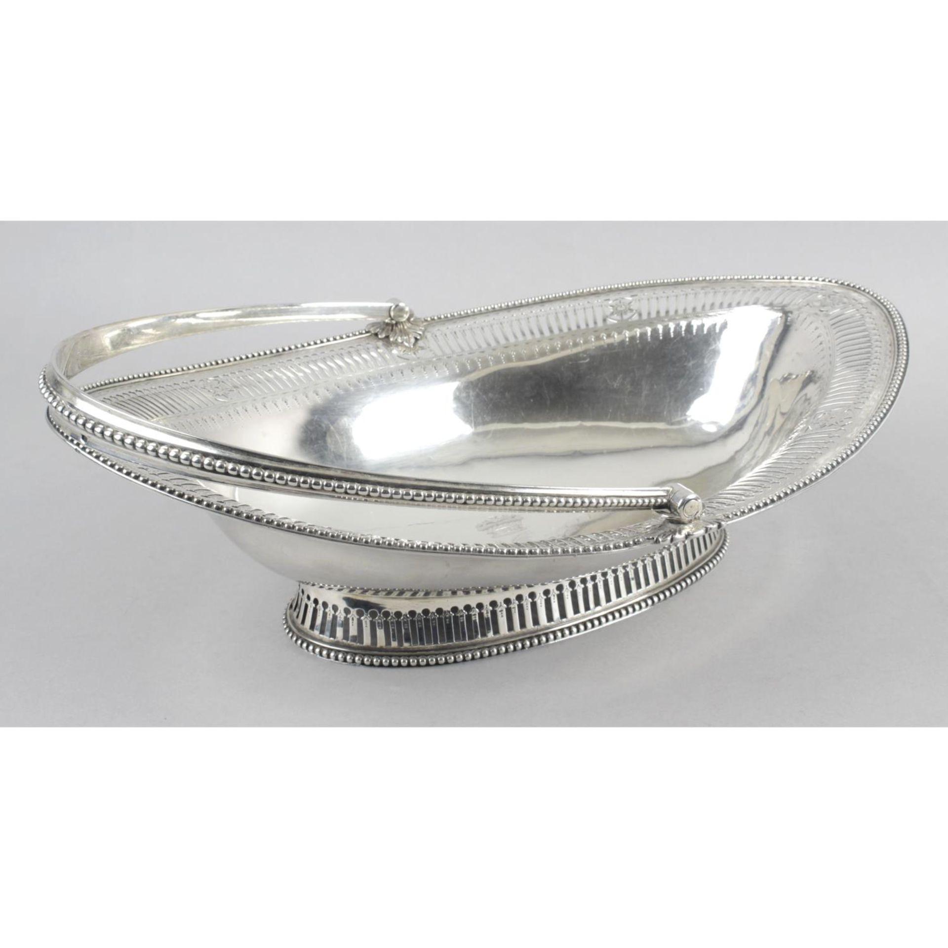 A George III silver swing-handled cake basket,