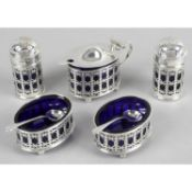 A matched early 20th century silver condiment set,