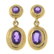 A pair of 9ct gold amethyst earrings.Import marks for Birmingham.Length 1.9cms.