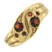 A 9ct gold garnet double snake ring.Hallmarks for 9ct gold.
