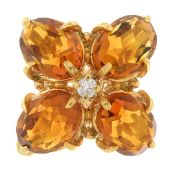 A citrine and diamond floral cluster ring.Stamped K18.