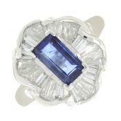 An 18ct gold sapphire dress ring, with diamond undulating surround.
