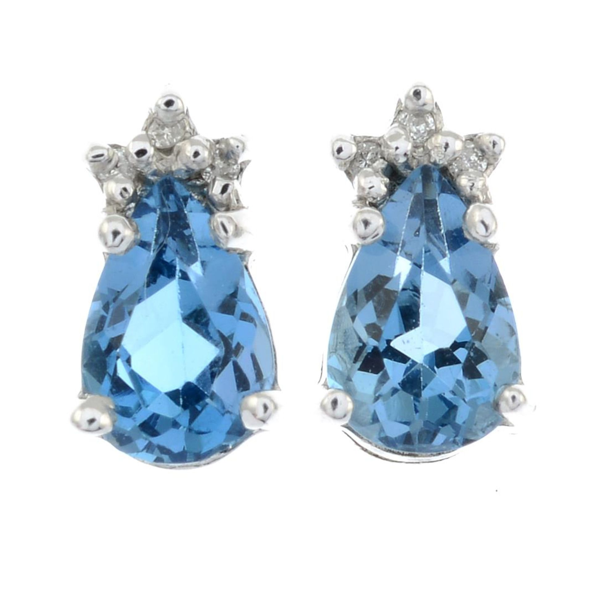 A pair of blue topaz and diamond stud earrings.Stamped 375.Length 0.8cms.