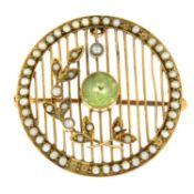 An Edwardian peridot and split pearl brooch, with openwork detail.