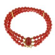 A coral bead three-row bracelet,