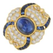 A sapphire cabochon and brilliant-cut diamond dress ring.Principal sapphire calculated weight
