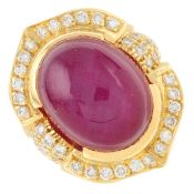 A star ruby cabochon and brilliant-cut diamond cluster ring.Estimated dimensions of ruby 18.1 by
