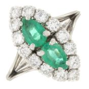 An emerald and brilliant-cut diamond dress ring.Total emerald weight 0.72ct,