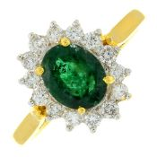 An emerald and brilliant-cut diamond cluster ring.Emerald weight 1.04cts.Total diamond weight