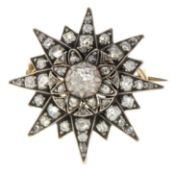 An early 20th century gold and silver old-cut diamond star brooch.May be worn as a pendant.